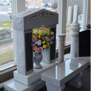 header stone with flowers vase inside